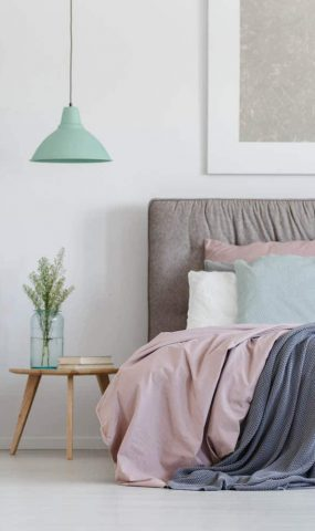 bed-with-pastel-bedding-PHRKGR5.jpg